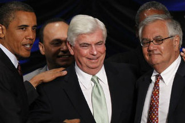 President Barack Obama, left, stands with Sen. Chris Dodd, D-Conn., center, and Rep. Barney Frank, D-Mass., right, after he signed the Dodd-Frank Wall Street Reform and Consumer Protection financial reform bill, Wednesday, July 21, 2010. (AP Photo/Charles Dharapak)