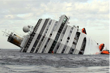 The luxury cruise ship Costa Concordia lies on its side after it ran aground near the island of Giglio, Italy on Jan. 13. (AP Photo/Andrea Sinibaldi, Lapresse)