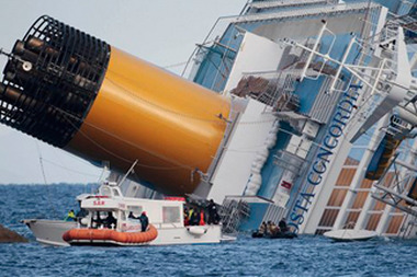 Sunday's collision caused a 160-foot gash in the Costa Concordia's hull and the evacuation of more than 4,200 passengers. (AP Photo/Gregorio Borgia)