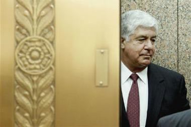 AIG CEO Robert Benmosche boards an elevator o