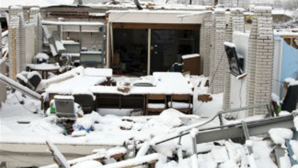 A real estate office without roof or walls after tornado damage in West Liberty, Ky., March 5. (AP Photo/John Flavell)