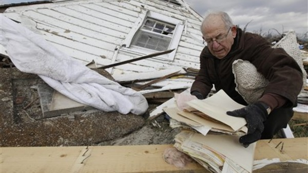 A resident searches through a home destroyed by a tornado in Marysville, Ind., March 4, 2012. (AP Photo/Nam Y. Huh)