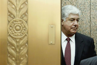AIG CEO Robert Benmosche boards an elevator on Capitol Hill in Washington, May 26, 2010. (AP Photo/Pablo Martinez Monsiva