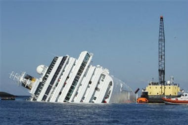The grounded cruise ship Costa Concordia off the Tuscan island of Gig
