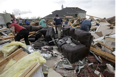 Homeowners in Forney, Texas sift through the wreckage left by a tornado April 3. (AP Photo/Tony Gutierrez)