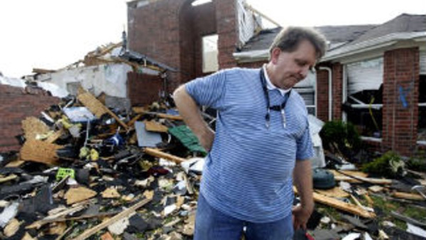 A homeowner in Forney, Texas walks through a debris field left over from his tornado-damaged home on April 4. (AP Photo/Tony Gutierrez)