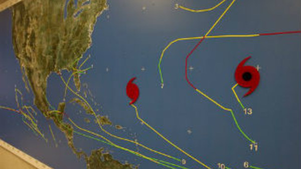 A map at the National Hurricane Center in Miami shows the location of tropical weather systems Thursday, Sept. 6, 2012. Hurricane Leslie is south of Bermuda. (AP Photo/J Pat Carter)