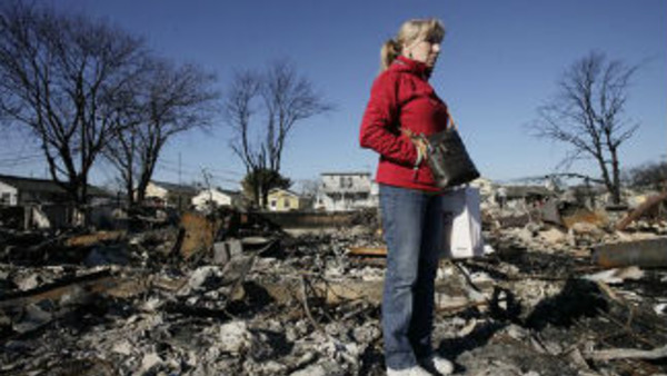 A fire destroyed more than 50 homes in the Breezy Point section of the Queens borough of New York during Superstorm Sandy. (AP Photo/Mark Lennihan)