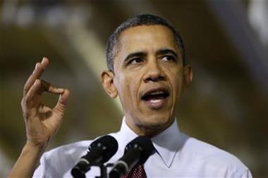 President Barack Obama speaks at the Daimler Detroit Diesel plant in Redford, Mich. on Dec. 10, 2012. (AP Photo/Charles Dharapak)