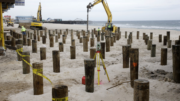 Heavy machines place pilings into the sand Tuesday, Feb. 19, 2013, in Seaside Heights, N.J., where workers have begun rebuilding the boardwalk that was destroyed by Superstorm Sandy. (AP Photo/Mel Evans)