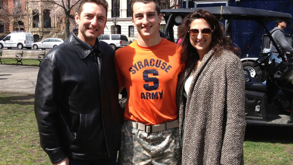 I.I.I.'s Bob Hartwig poses with his son and wife shortly after his son completed the Boston Marathon April 15. Two deadly explosions rocked the area near the finish line a little more than an hour later.