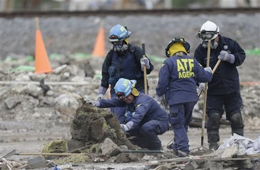 Investigators early this month look through the debris of the destroyed fertilizer plant in West, Texas (AP Photo/LM Otero)