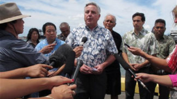 Matson Navigation Co. CEO Matt Cox speaks during a news conference in Honolulu. Cox says the company responsible for spilling 1,400 tons of molasses in Hawaii waters will fully pay for cleanup and other costs. (AP Photo/Oskar Garcia)