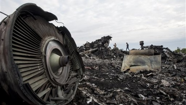 The crash site of the Malaysia Airlines jet in eastern Ukraine on July 19. (AP Photo/Evgeniy Maloletka)