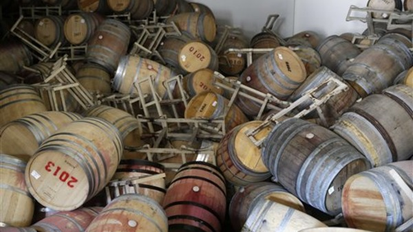 Barrels are toppled on one another following an earthquake at the B.R. Cohn Winery barrel storage facility on Aug. 24 in Napa, Calif. (AP Photo/Eric Risberg)