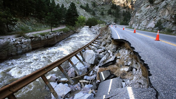 A guardrail hangs away from a closed canyon road, which links Boulder with the mountain town of Nederland, and which was washed out in places by the 2013 floods, west of Boulder, Colo.(AP Photo/Brennan Linsley, File)