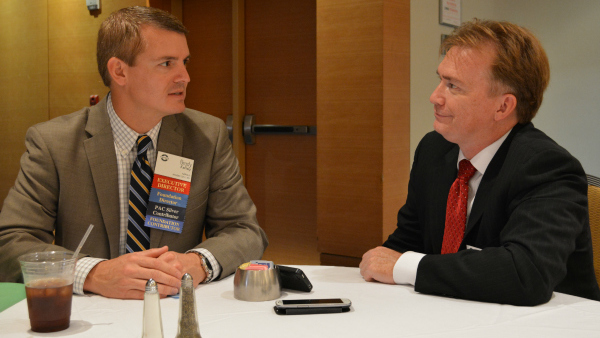 NAPSLO executive director Brady Kelley, left, and Shawn Moynihan, Editor-In-Chief of National Underwriter Property & Casualty, chat during the association's annual convention in Atlanta.