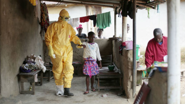 A 9-year-old girl is taken to an ambulance after showing signs of Ebola infection in the village of Freeman Reserve, about 30 miles north of Monrovia, Liberia. (AP Photo/Jerome Delay)