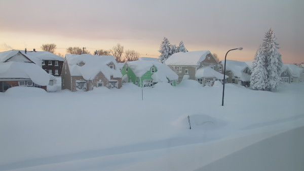 Snow covers a street at daybreak Wednesday, Nov. 19, 2014, in south Buffalo, N.Y. (AP Photo)