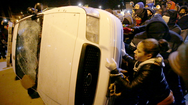 Protesters vandalize a police vehicle outside of the Ferguson city hall on Nov. 25 in Ferguson, Mo. (AP Photo/David Goldman)