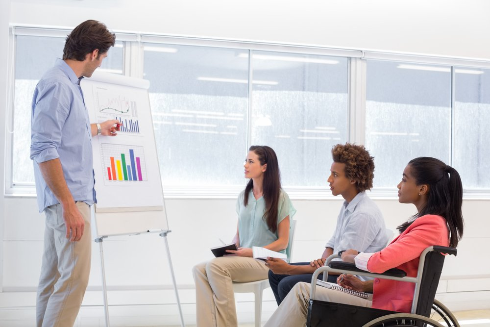 Woman in wheelchair attending business meeting