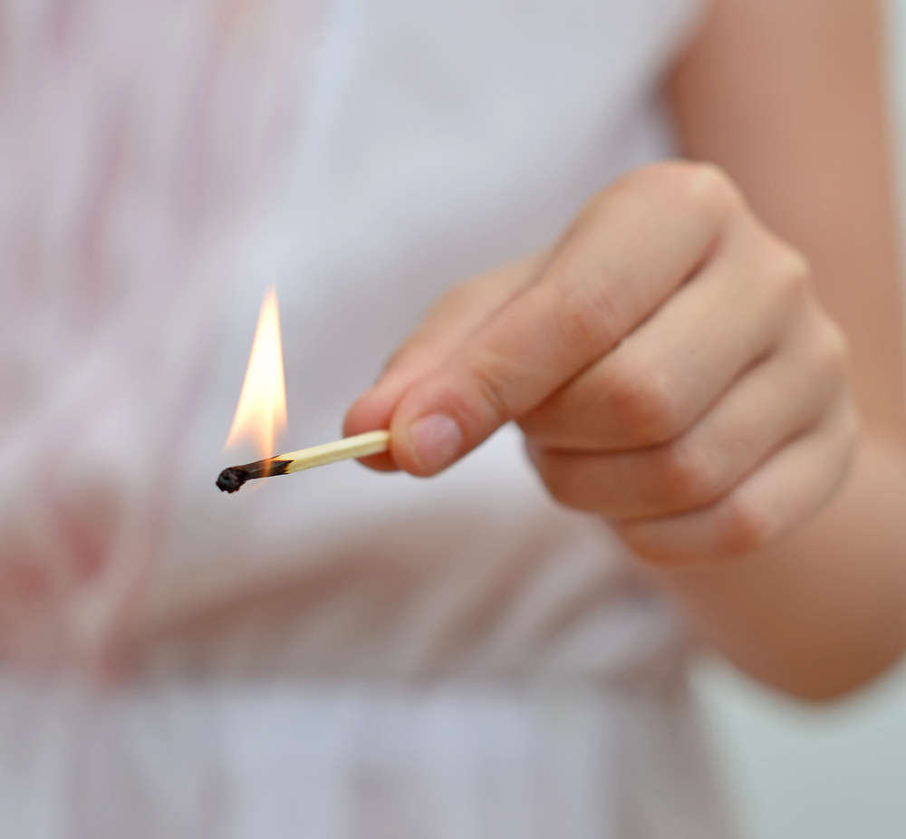 Children playing with fire