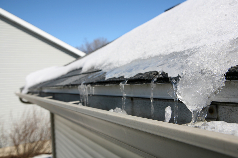 Ice dam in gutter of house