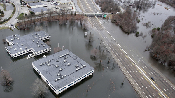 Commercial buildings underwater during Superstorm Sandy. (AP Photo/Charles Krupa)