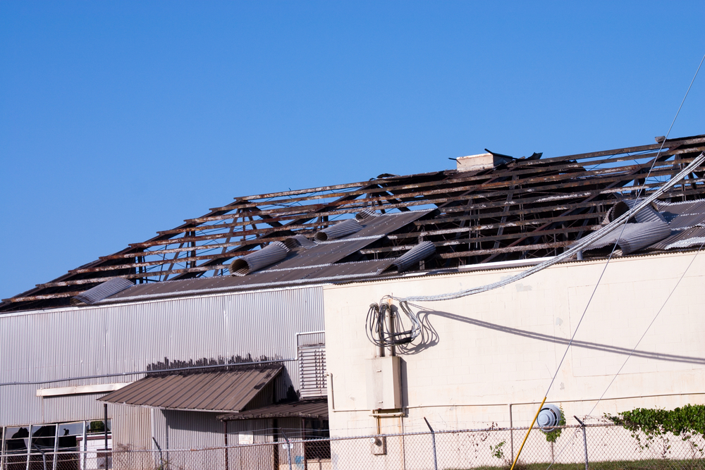 Commercial building with damaged roof