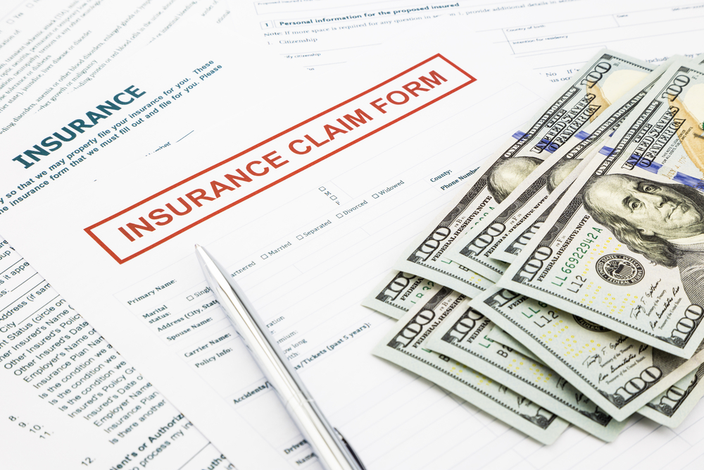 Insurance claims form with money