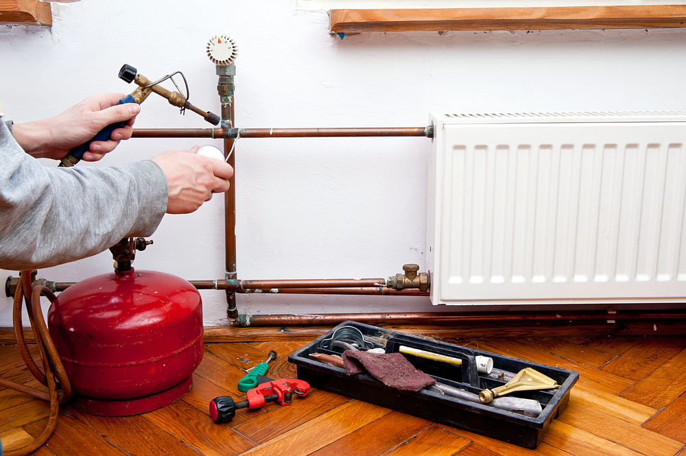 Man welding copper pipe