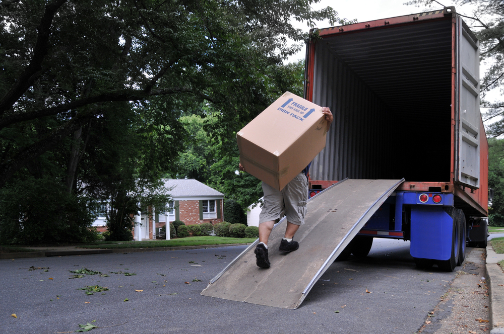 Man moving box into truck