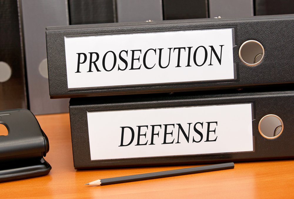 Binders reading prosecution and defense