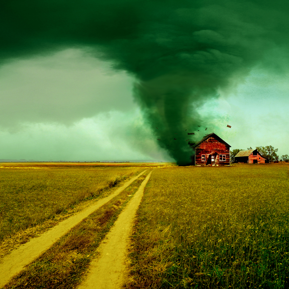 tornado near a farm house