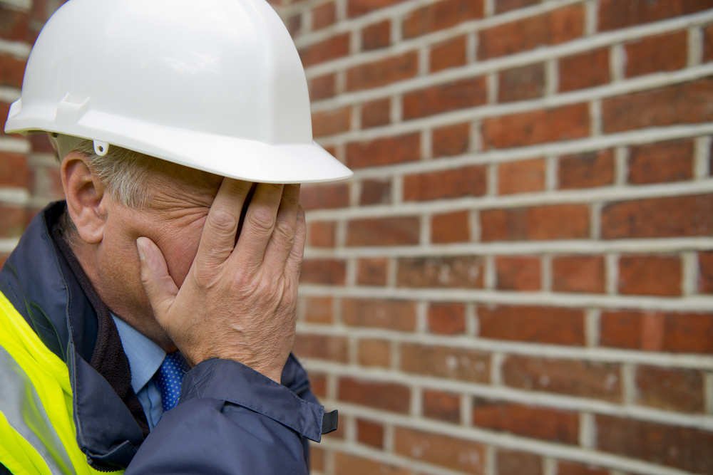 Distraught construction worker