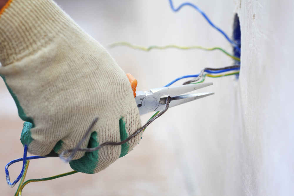 Electrician's hand splicing wires