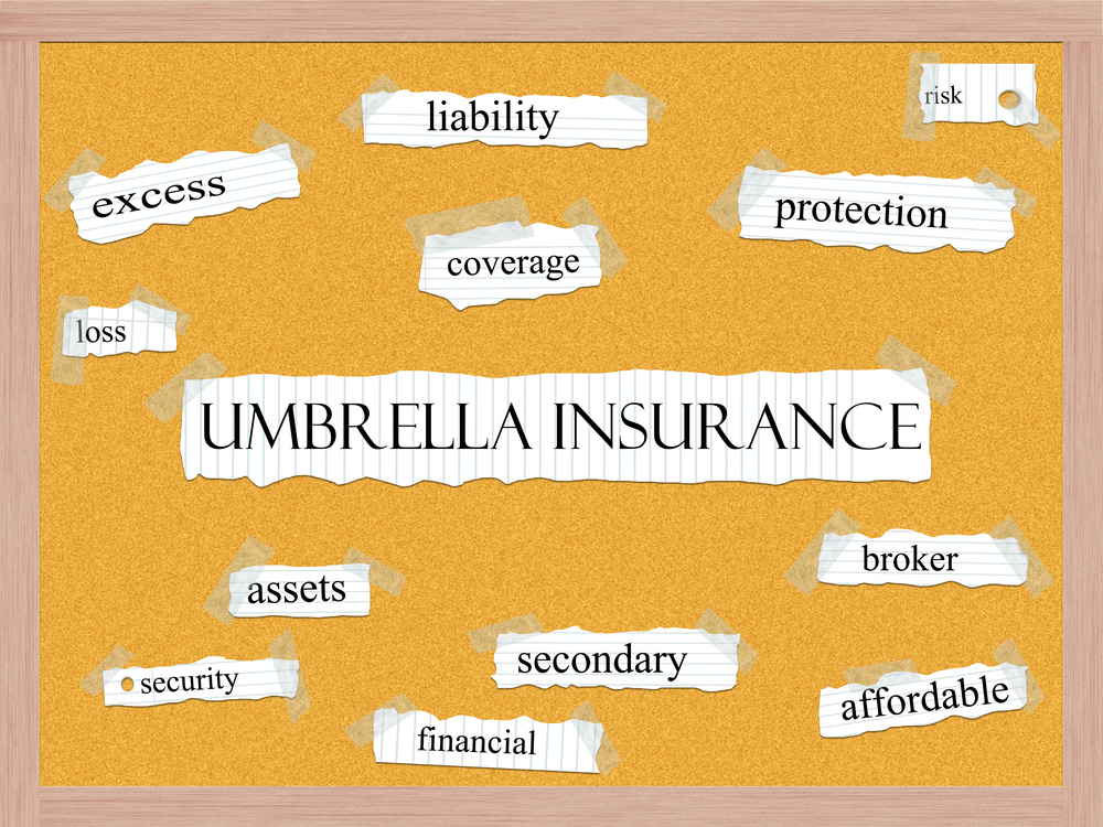 Bulletin board with umbrella insurance centered