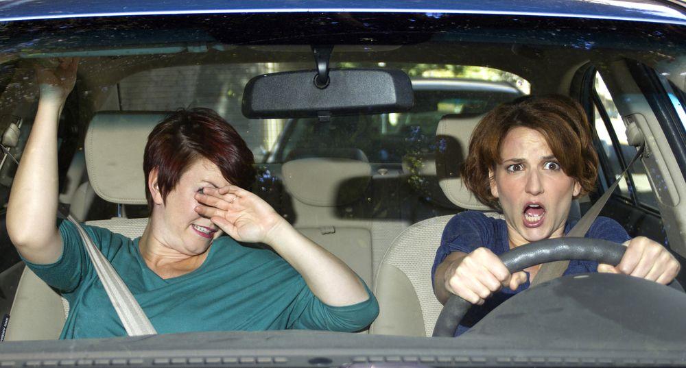female driver and passenger avoiding car crash