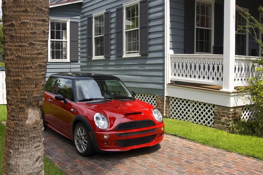 Red Mini Cooper in driveway of house
