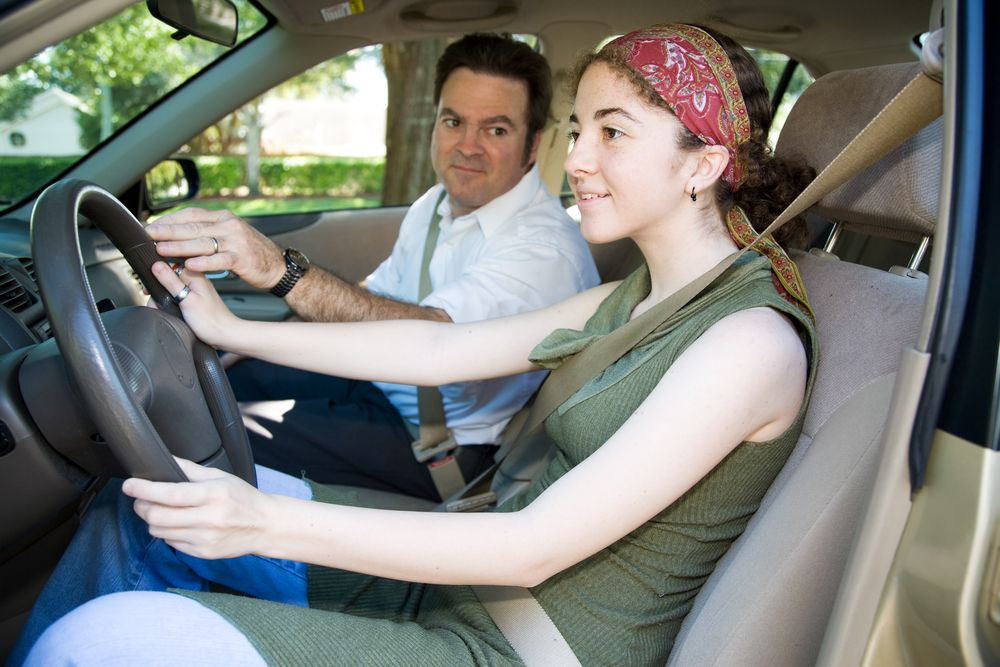 father teaching daughter to drive