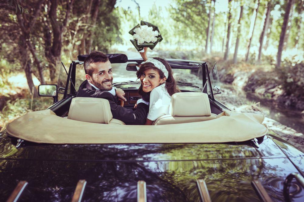 newlyweds in car