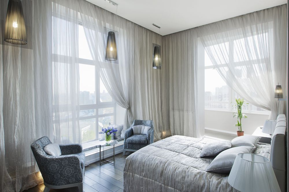 cozy bedroom with window coverings