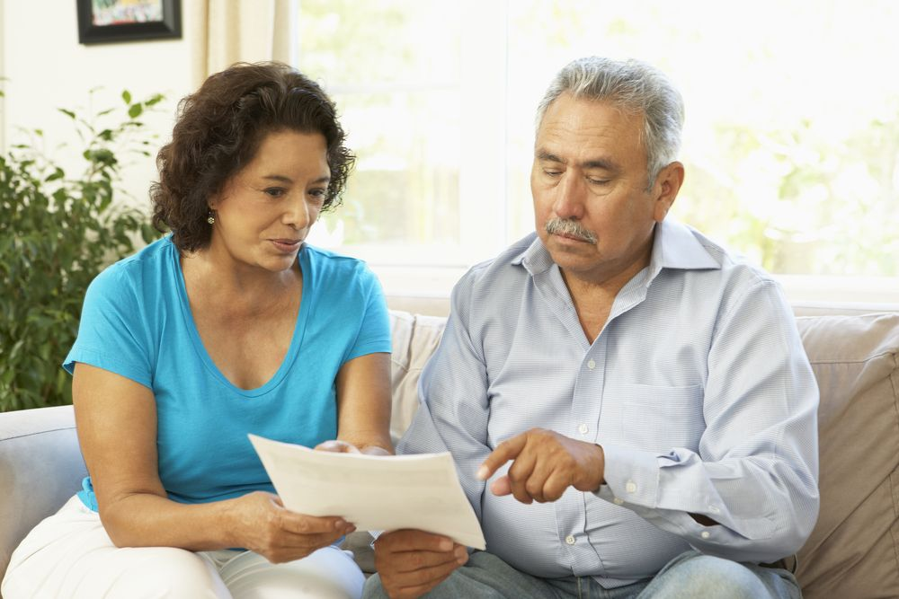 Couple reading homeowners insurance policy