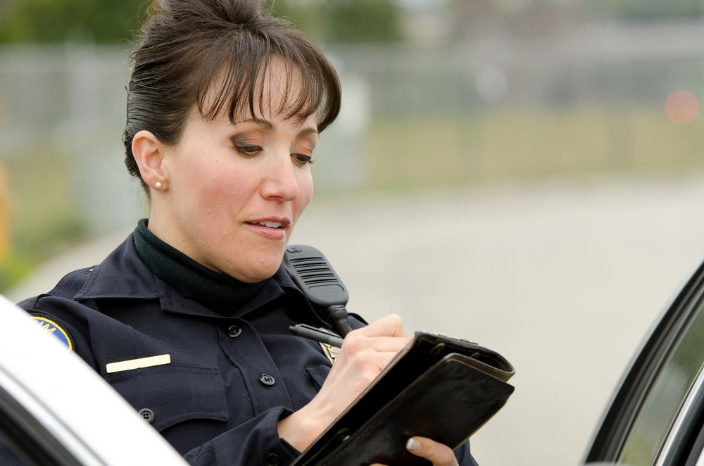 policewoman writing a ticket