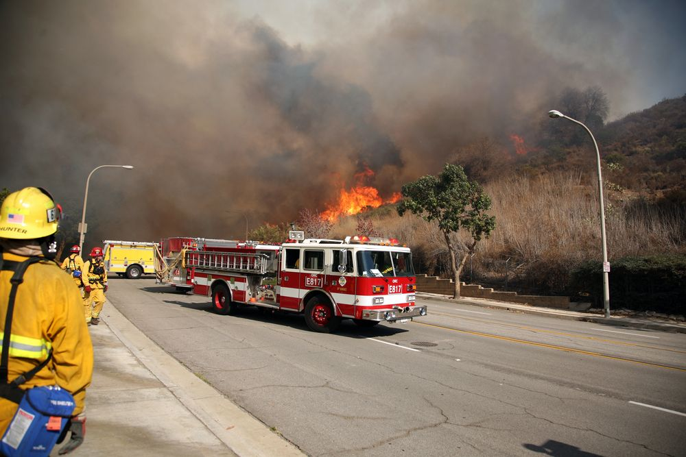 Firefighters and emergency personal rush to control fires in Brea, California