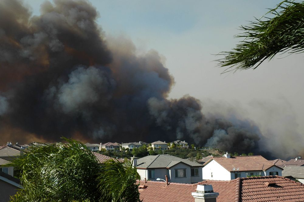 wildfire approaching homes in southern California