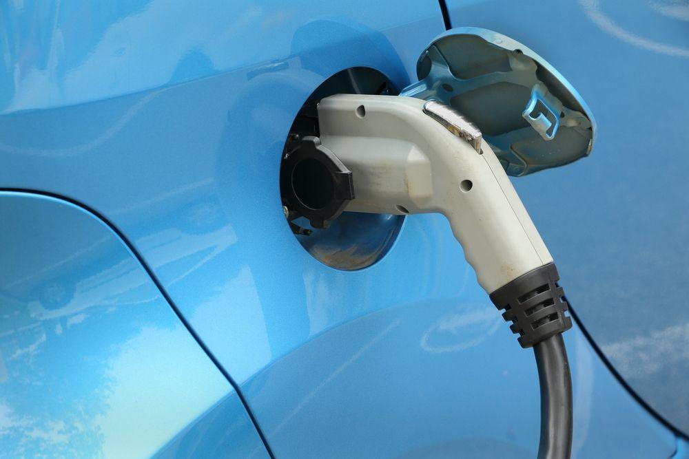 Blue electric car plugin