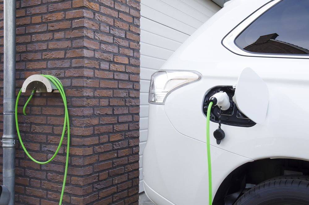 electric car charging in home driveway