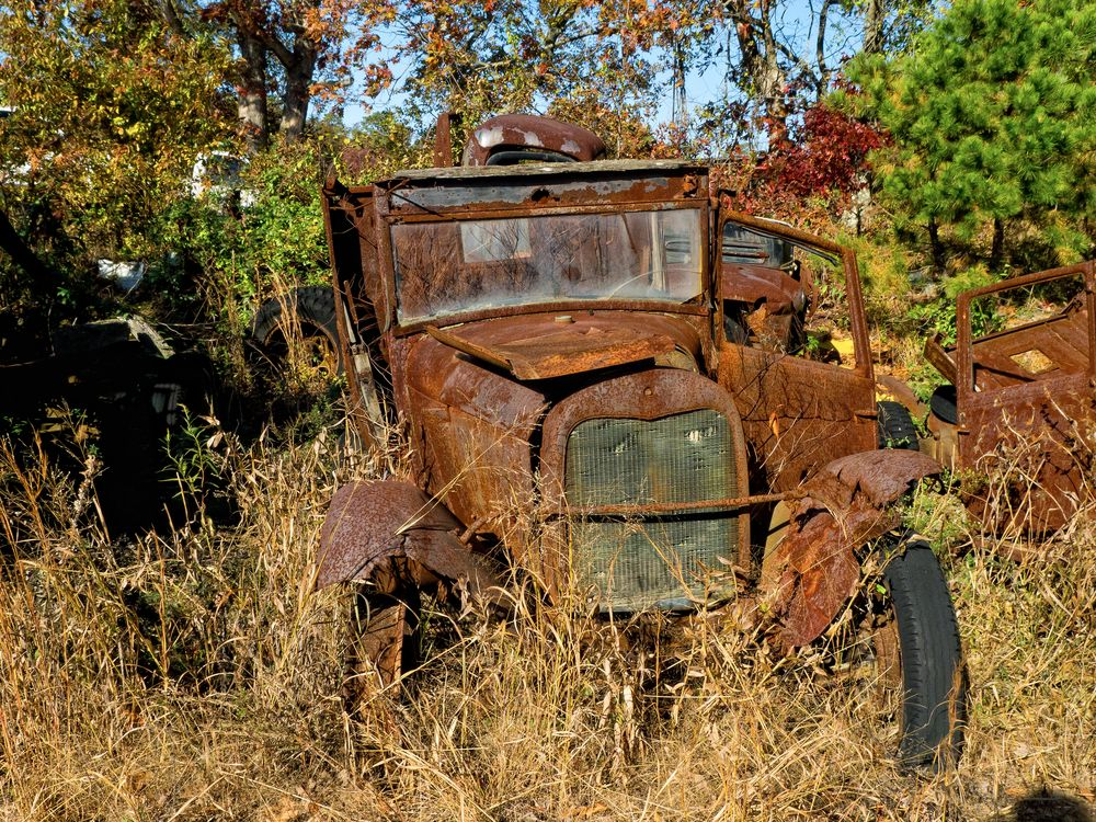 rusted old Ford Model-T