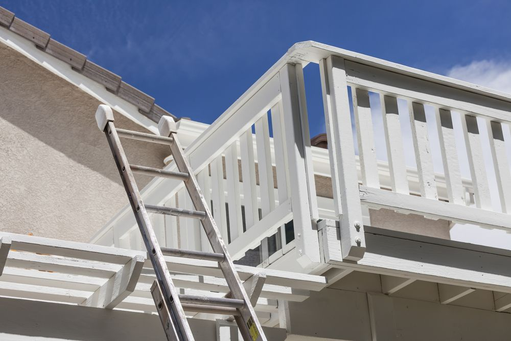 ladder leaning against second floor deck
